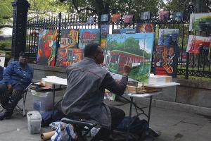 ジャクソン・スクエアで絵を描く人